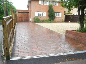 3 Size Block paving with tumbled edge. Drainage formed using an Aco Channel leading to a soak away.