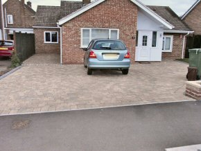 Block paving driveway with uniformed size edging of the same stone.