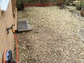 Indian sandstone patio in Cullompton, Devon (Before)