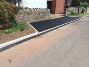 New dropped kerb and tarmac area