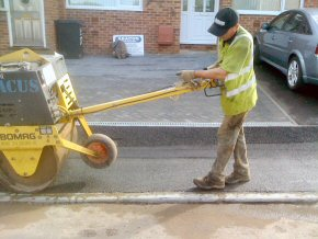 Form new driveway in block pavers with a drop kerb. A tarmac pathway with Aco channels is connected to a new soak-away