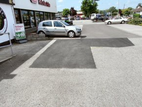 Patch repair tarmac outside Majestic wines in Taunton